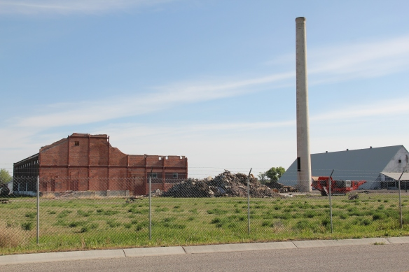 The refinery, shown here in 2013, is  just east of the town proper and has served as a major landmark for travelers on I-94.