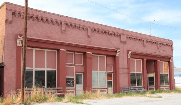 Brick stores, symmetrical plan, Melrose