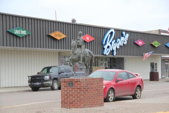 Roosevelt Co Wolf Point 3 cowboy sculpture Homage by Floyd DeWitt